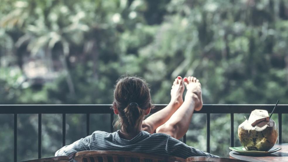 girl sitting alone in her balcony