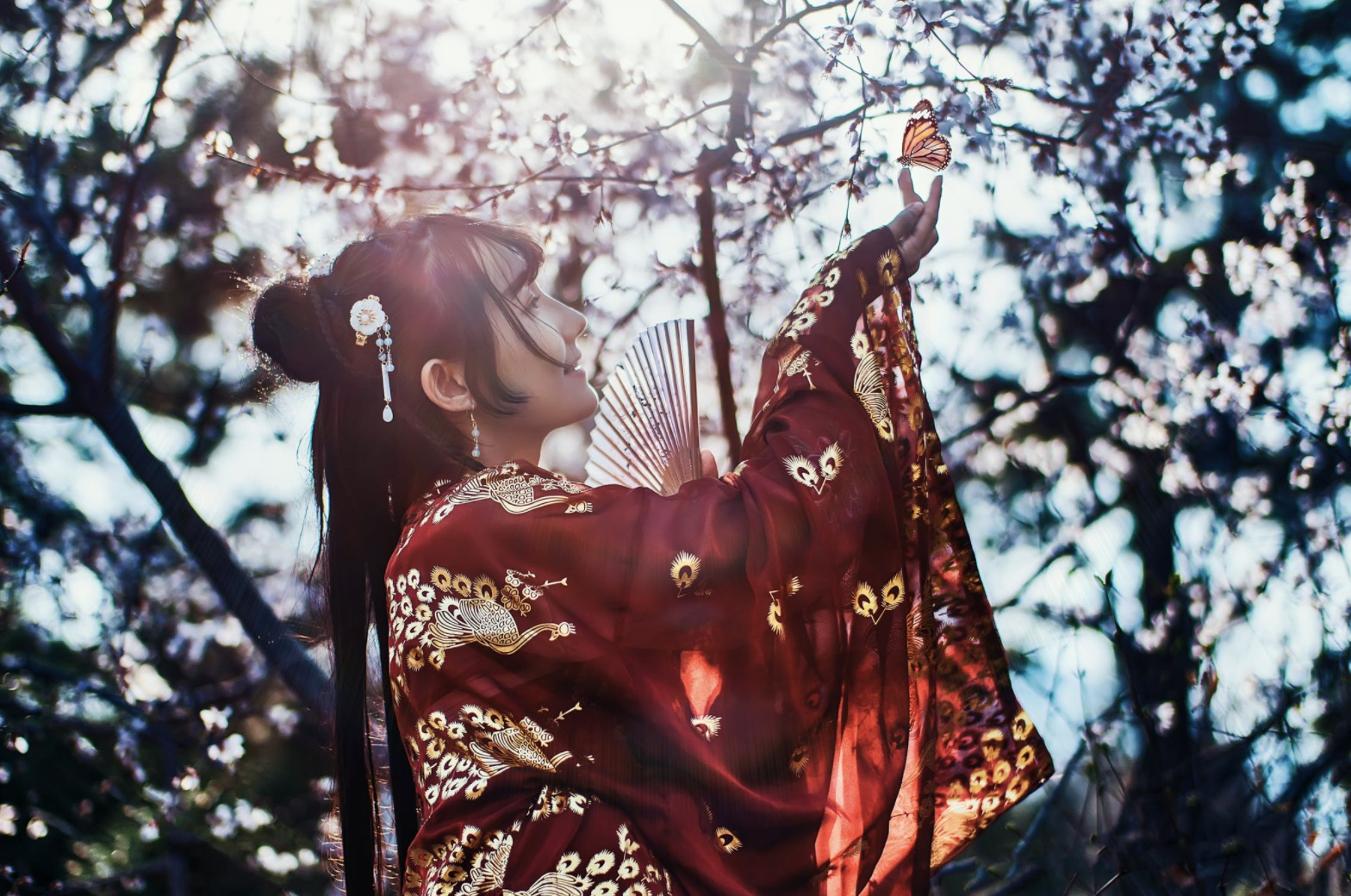 girl finding a butterfly in tree