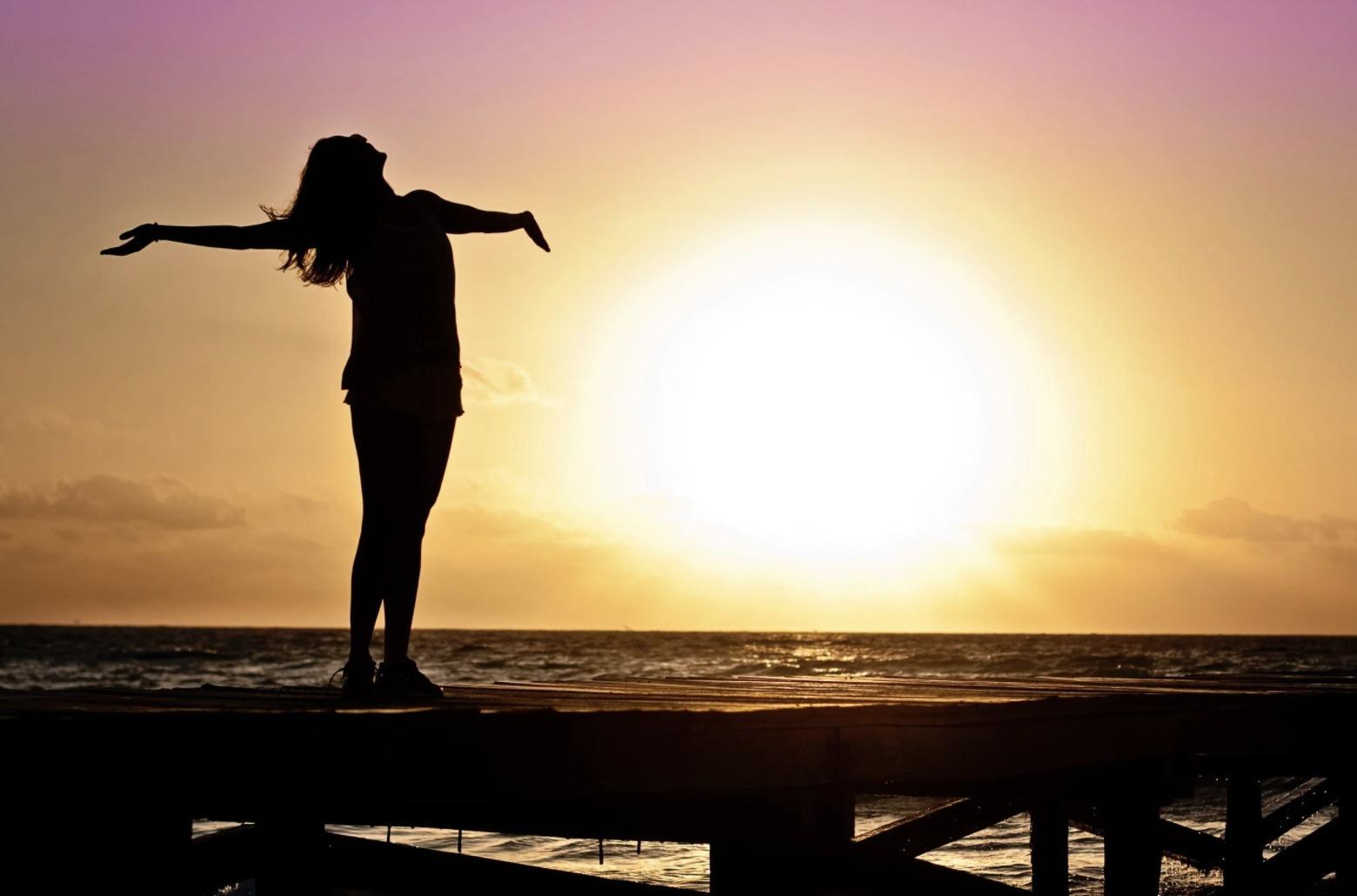 girl on beach in sunset