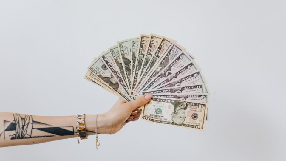 girl holding money in her hand