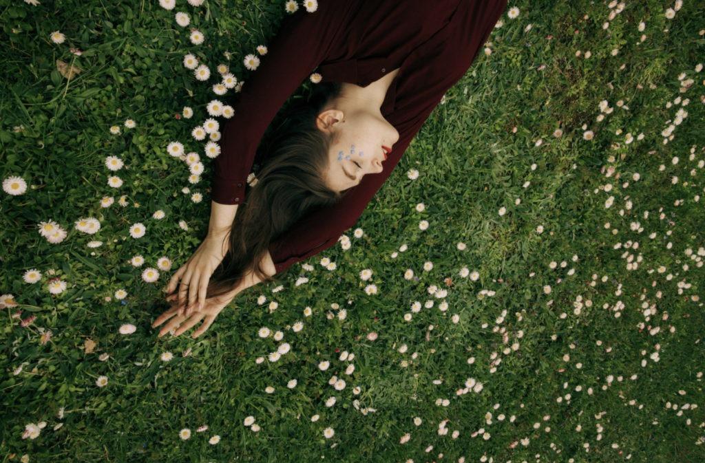 girl sleeping on field