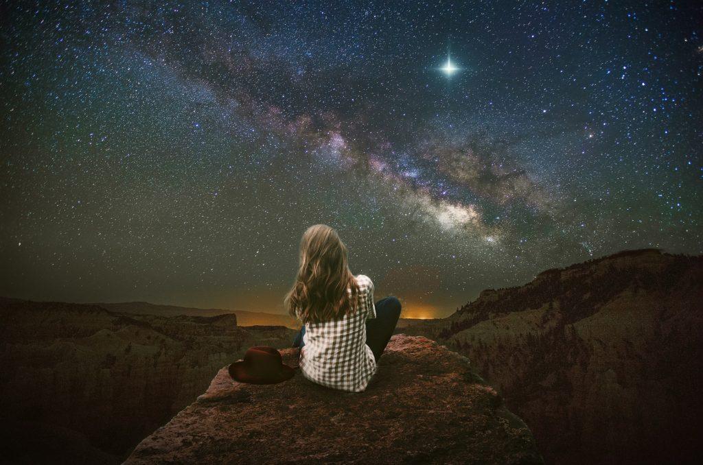 Woman gazing at stars