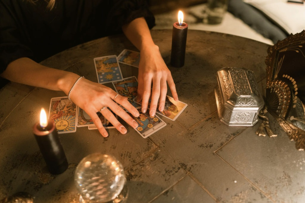 girl doing tarot reading with candles
