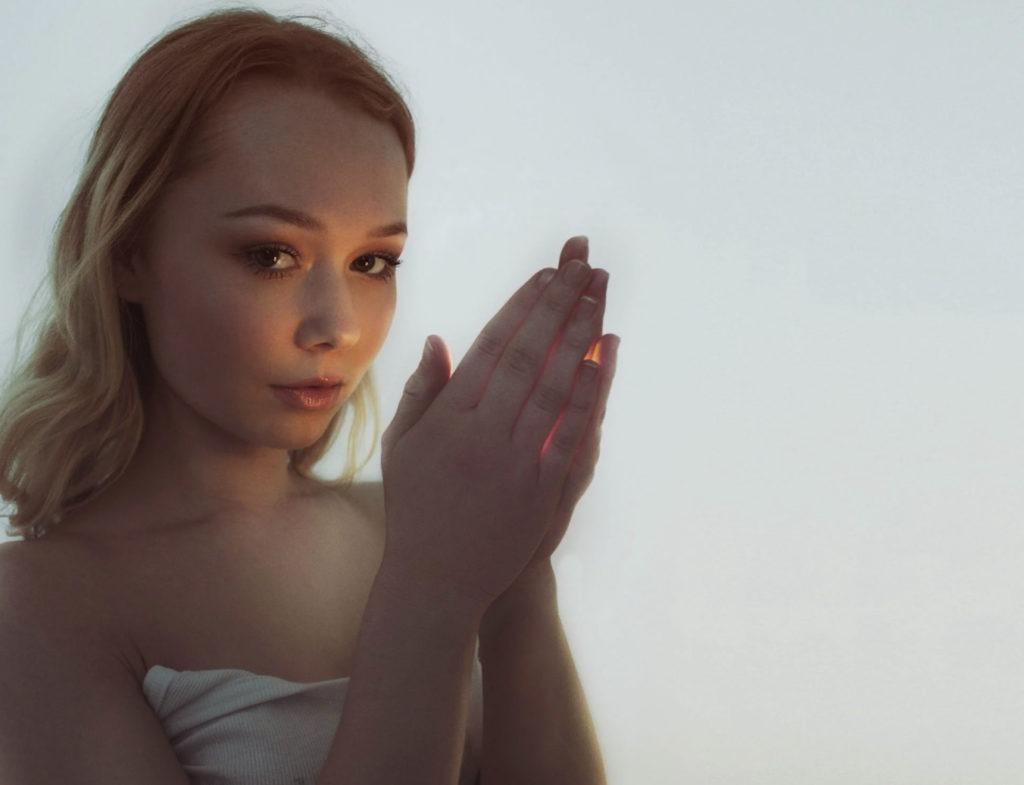 girl holding a light